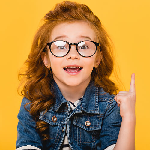 girl with glasses pointing